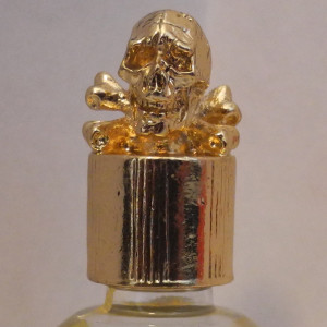 skull and crossbones gold vial